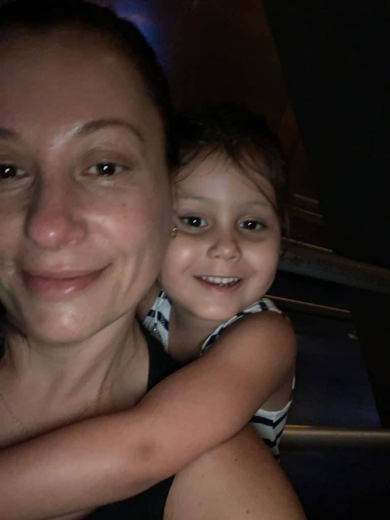 single mom and daughter smiling
