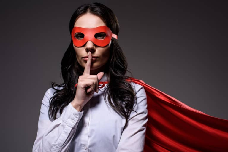 Superwoman wearing mask and cape