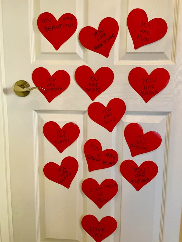 Single Parent On Valentine's Day Written Paper Hearts On The Door