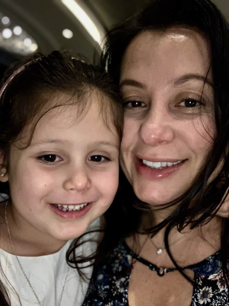 Woman And Daughter Smiling Selfie