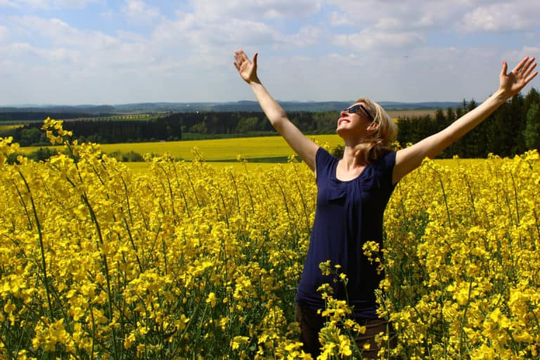 Be Obsessively Grateful A Woman in a Field
