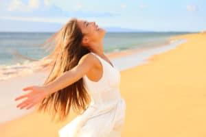 Self Care Ideas Free happy woman on beach