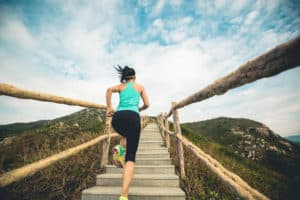 Inspirational Quotes About Life And Struggles Young fitness woman trail runner running up on mountain stairs