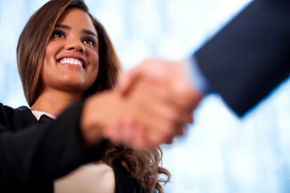 Benefits of Self-Confidence A handshake between business people