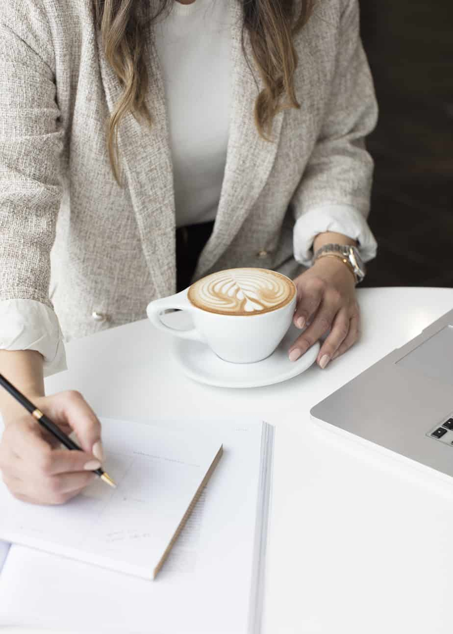 How To Be A Boss Lady - woman with a cup of coffee and writing