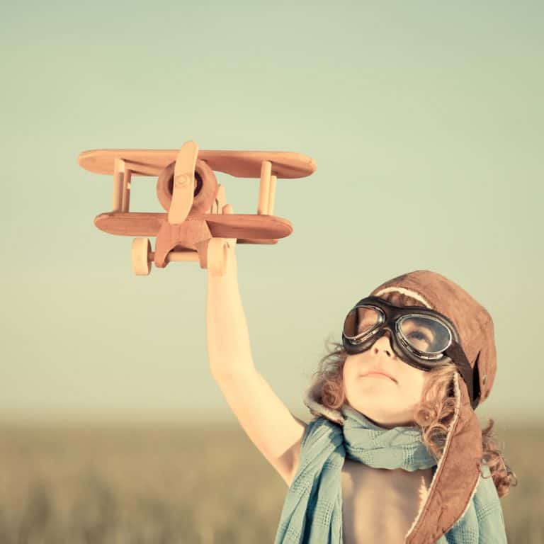 Know Your Purpose Find Joy Happy kid playing with toy airplane